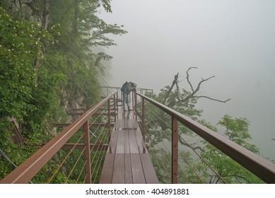 The guy walks through the Canyon Okatse Kutaisi, Georgia