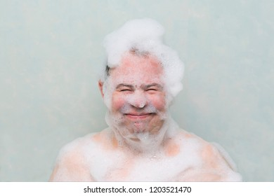 the guy washes in the bathroom with his head in the lather
