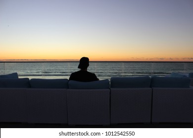 Guy Watching Sunset On Rooftop By Pacific Ocean