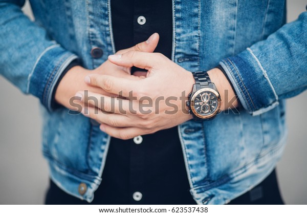 the guy in the white jacket and shirt adjusts watches, accessories men's look