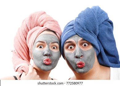 guy with woman looks at camera and send an air kiss, mask for skin, make mask for skin together, funny couple of lovers, isolated photo emotional gender role