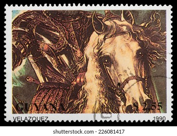 GUYANA - CIRCA 1990: a stamp from Guyana shows a Velazquez painting of a horseman in armour, circa 1990