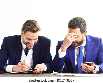 Guys with confused faces, papers and smartphone. Men disagree about business deal. Partners smile and discuss business. Bad offer, stupid idea concept. Wrong way, business mistake, contract fraud.
