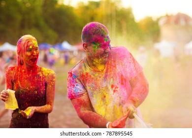 Guys with a girl celebrate holi festival