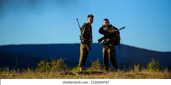 Guys hunting nature environment. Hunting season. Masculine hobby activity. Men bearded hunters with rifle nature background. Experience and practice lends success hunting. How turn hunting into hobby.