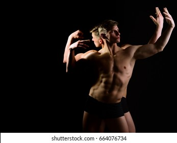 guys, muscular twin men with bare torso and six pack in underwear with athletic body on black background, alter ego, gay and homosexual, copy space