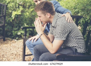 Guys Sharing Life Problems Always Support Best Friends. Friends Getting Down Heart Broken. Sad Man sitting outdoor in the park feeling sadness has a problems Life Crisis. Best Friend Mental Concept.