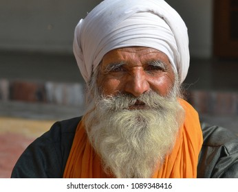 GWALIOR, INDIA - DEC 21, 2014: Old Sikh community leader with white beard and white Sikh turban (dastar) poses for the camera, on Dec 21, 2014/