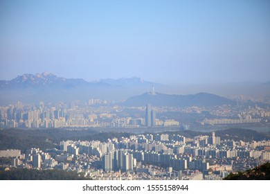 Gwanak-gu Seoul Korea. October 27rd. 2019: Early in the morning of autumn, the view of Seoul from Mt. Gwanak (Han River and Bridges, Seoul Tower, 63 Building, and downtown buildings)