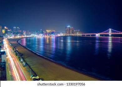 Gwangalli Beach, Gwangan Bridge and Busan skyline in Busan in the night. Busan,  South Korea. Aerial view