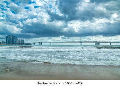 GwangAn Bridge and Haeundae beach and cloudy in Busan,South Korea.