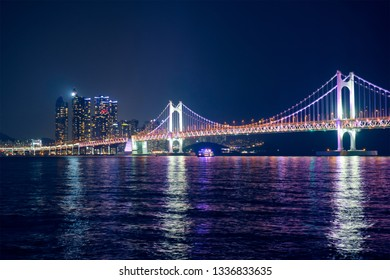 Gwangan Bridge and skyscrapers illuminated in the night. Busan, South Korea