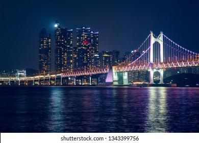 Gwangan Bridge and skyscrapers illuminated in the night. Busan, South Korea
