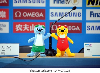 Gwangju, South Korea - July 23, 2019. Suri and Dari otter mascots of the FINA Swimming Championships on the table of the press conference room.
