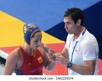 Gwangju, South Korea - July 26, 2019. OCA GAIA Miguel head coach speaks to FORCA ARIZA Judith (9). Spain played against USA in the Final of the FINA Women Waterpolo World Championship.