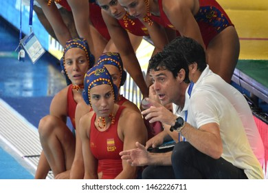 Gwangju, South Korea - July 26, 2019. OCA GAIA Miguel head coach of the Spanish team speaks to his team in the break. Spain played against USA in the Final of the Women Waterpolo World Championship.