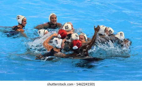 Gwangju, South Korea - July 26, 2019.  Members of the U.S. women's water polo team celebrate their victory over Spain in the final match at the FINA Women Waterpolo World Championship.
