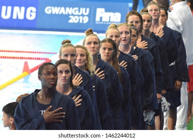 Gwangju, South Korea - July 26, 2019. USA  women waterpolo team listening the anthem. USA played against Spain in the Final of the Women Waterpolo World Championship.