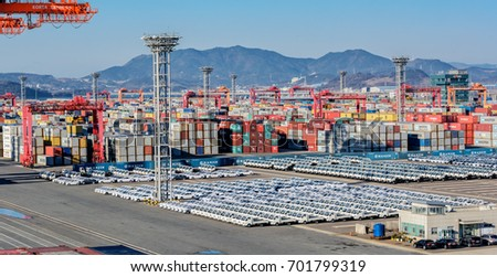 GWANGYANG, SOUTH KOREA - Feb 18, 2017: Rows of new cars waiting to be dispatch and shipped around the world from the cargo port in South Korea.