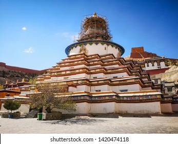 "Gyantse, Central Tibet / China - May 2019: The biggest Buddhist stupa in Tibet a stupa Kumbum in the monastery Pelkhor Chode. Translation is ""Stupa of Thousand Buddhas""."
