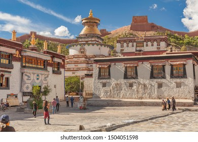 GYANTSE, TIBET - AUGUST 12, 2019: Magnificent Kumbum Stupa in Gyantse with fortress in background