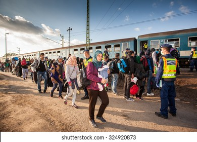 GYEKENYES- OCTOBER 5 : War refugees at the Gyekenyes Zakany Railway Station on 5 October 2015 in Gyekenyes, Hungary. Refugees are arriving constantly to Hungary on the way to Germany.
