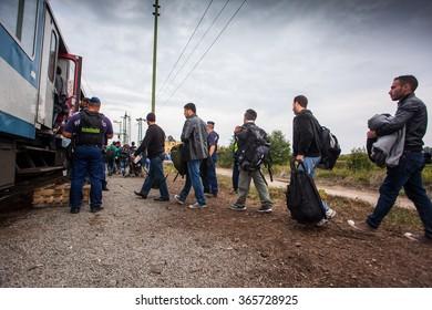 GYEKENYES- OCTOBER 6 : War refugees at the Gyekenyes Zakany Railway Station on 6 October 2015 in Gyekenyes, Hungary. Refugees are arriving constantly to Hungary on the way to Austria.