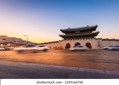 Gyeongbokgung Palace, Cars passing in front of Gwanghuamun gate after sunset in downtown Seoul, South Korea. Name of the palace 'Gyeongbokgung'