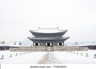 Gyeongbokgung palace frozen under snow on a stormy snowy day during winter in Seoul, Korea