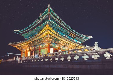 """Gyeongbokgung palace at night with writing in chinese meaning - """"diligence helps governance"""" - Seoul, Republic of Korea"""