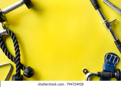 Gym background with Fitness equipment on yellow colorful background.