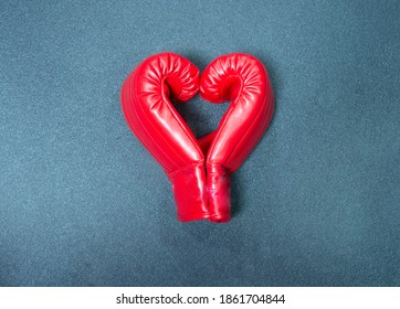 Gym background and fitness equipment and Valentine concept. Boxing glove in shape of heart