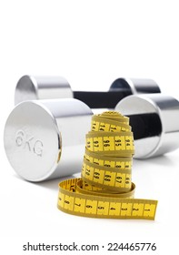 Gym Dumbbells isolated with a tape measure