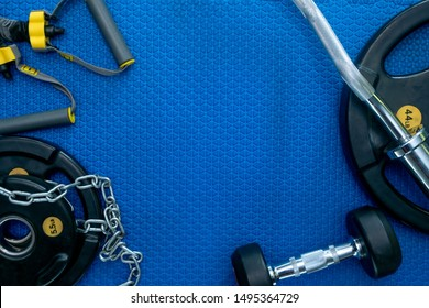 Gym equipment on floor. Accessories for fitness. Frame of Sport background with empty space.