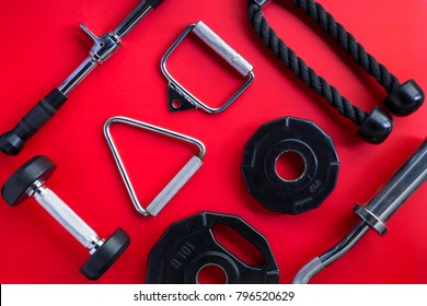 Gym equipment on red background