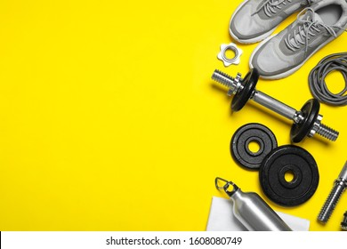 Gym equipment on yellow background, flat lay. Space for text - Shutterstock ID 1608080749