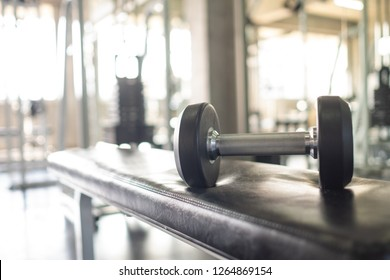 Gym Fitness and workout equipment: set of the modern dumbbells on the floor with background burred of gym fitness club.