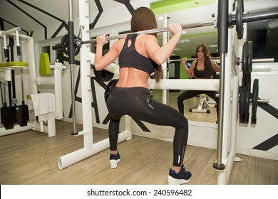 In the gym - girl is exercising in the gym