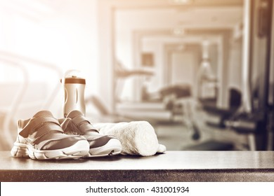 gym interior with retro effect and shoes and towel
