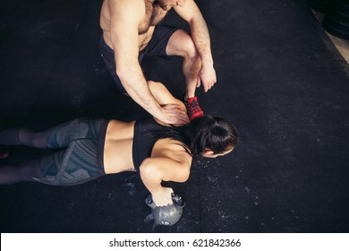 gym personal trainer man. woman workout in fitness exercise