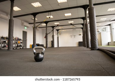 Gym room exercise studio interior with solitary kettlebell on the floor