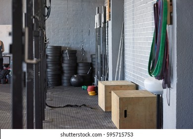 Gym scene venue location with sport crossfit equipment wooden box weights straps bars