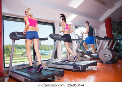 gym shot - people running on machines, treadmill