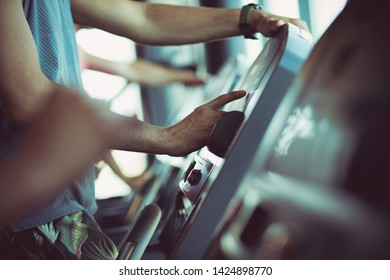 Gym technology. Man at gym.