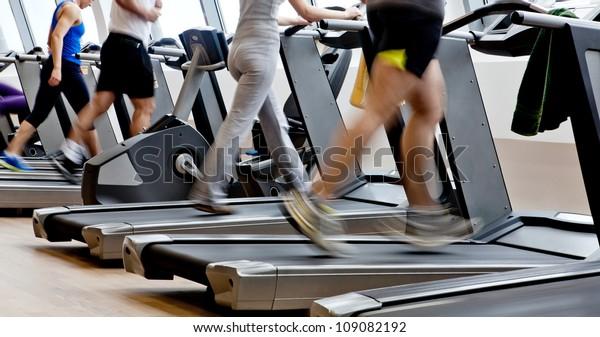 gym training - people running on machines, treadmill