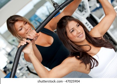 gym woman and her trainer doing exercise at the gym
