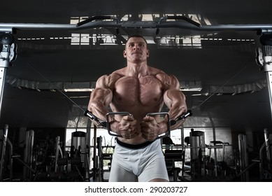in the gym.Bodybuider demonstrate crossover exercises
