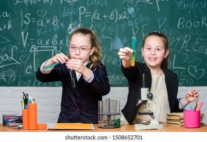 Gymnasium students with in depth study of natural sciences. School project investigation. School experiment. School for gifted children. Girls school uniform excited proving their hypothesis.
