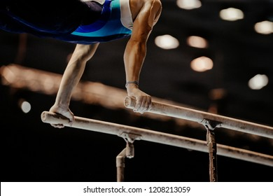 gymnast exercise parallel bars in artistic gymnastics