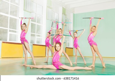 Gymnast girls with  juggling clubs training